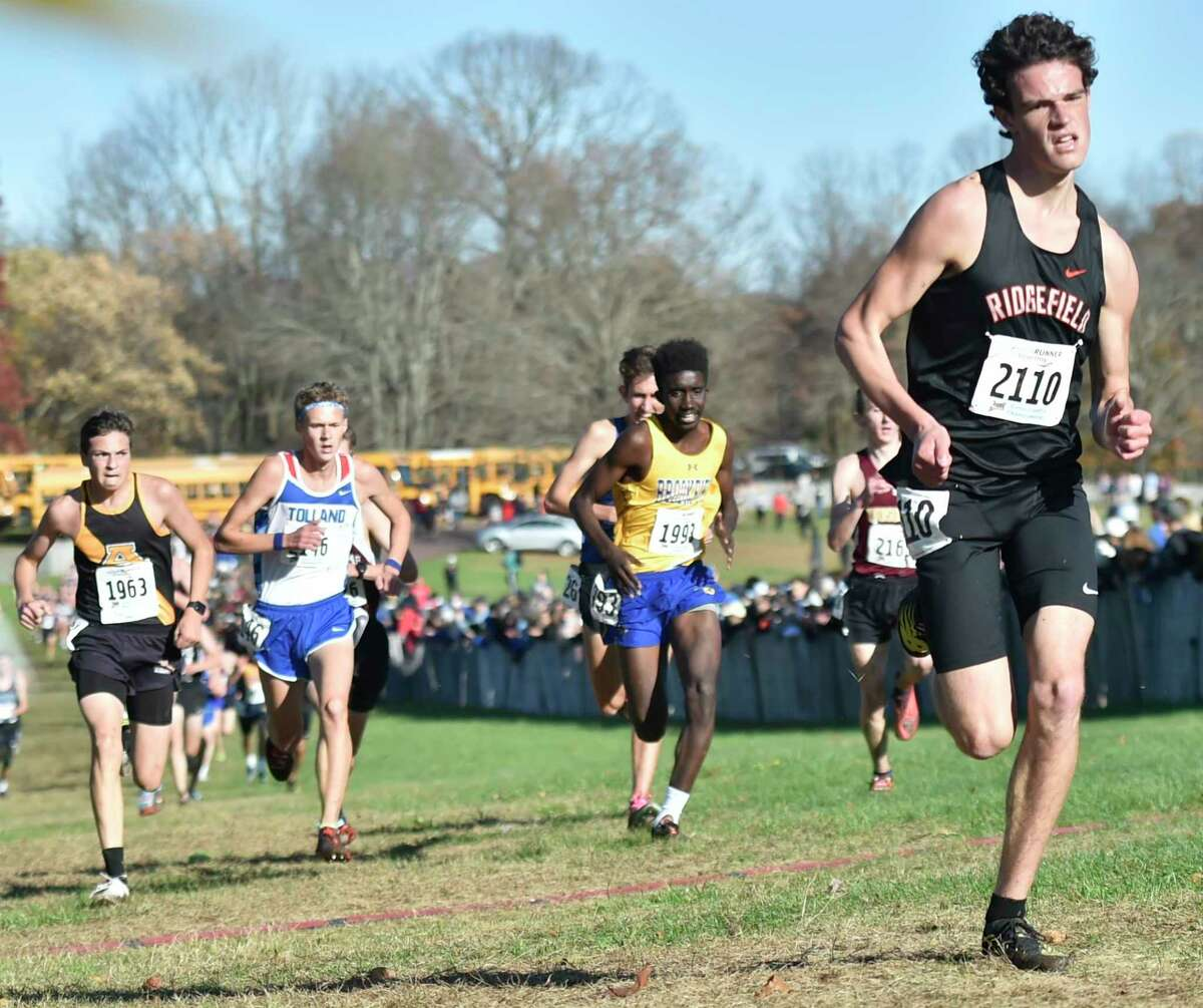 Manchester, Connecticut -Wednesday, November 1, 2019: 33rd place finisher Charles King of Ridgefield H.S. runs toward the finish line during the CIAC Boys Cross Country Open Championship Friday at Wickham Park in Manchester.
