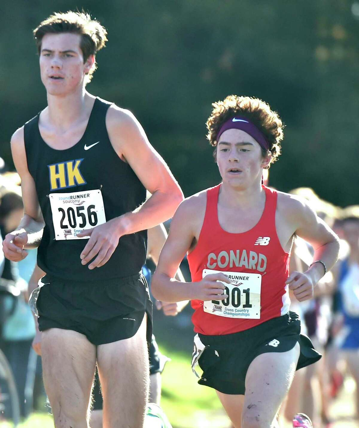 Manchester, Connecticut -Wednesday, November 1, 2019: 22nd place finisher Matt Jennings of Haddam-Killingworth H.S., left, and 9th place finisher Callum Sherry of Conard H.S., right, during the CIAC Boys Cross Country Open Championship Friday at Wickham Park in Manchester.