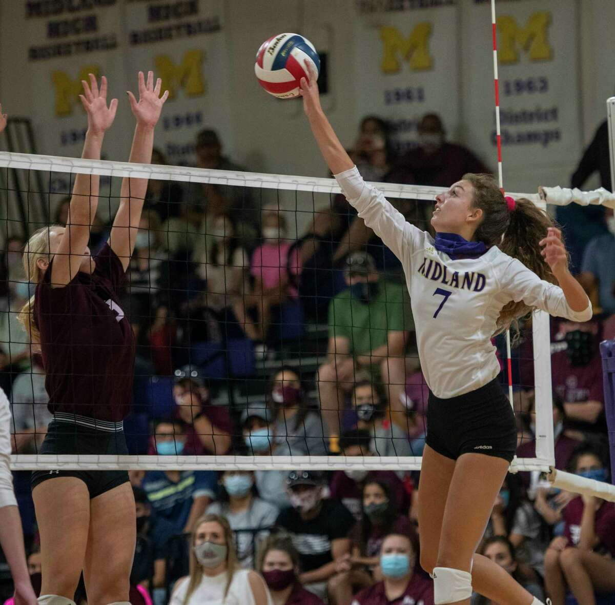 Midland High's Olivia Hale (7) hits the ball at Lee's Paige Prather on Friday, Oct. 2, 2020 at Midland High School. Jacy Lewis/Reporter-Telegram