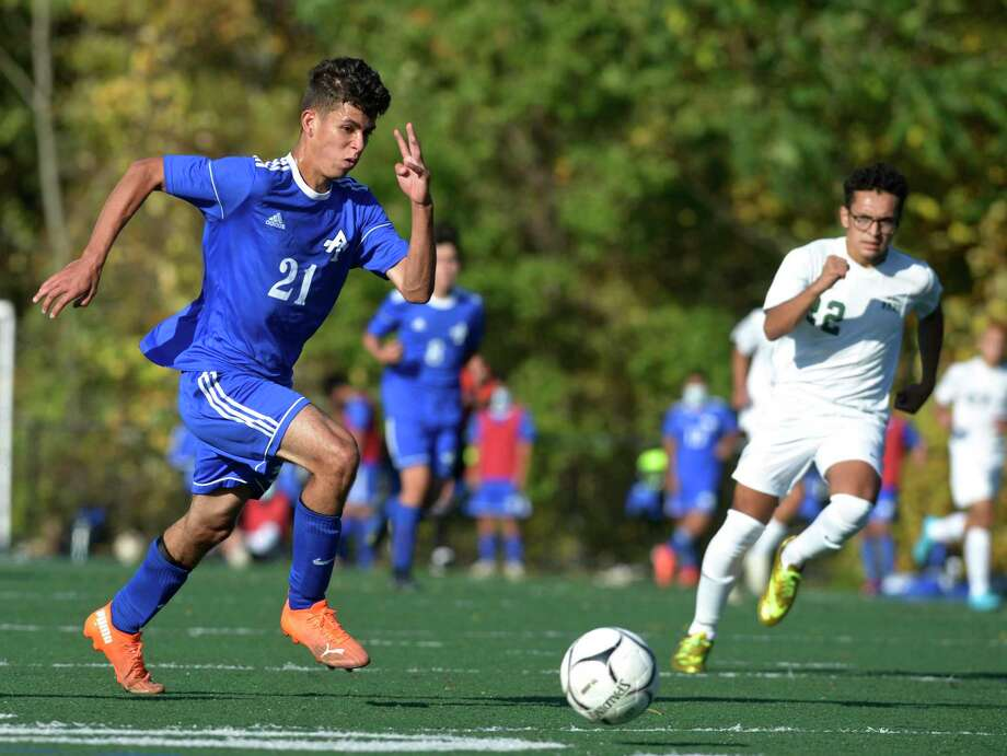 Abbott Tech's Michael Candido (21) moves the ball ahead of New Milford's Yousef Eltoukhy (22) during a boys soccer game on Thursday at Broadview Middle School in Danbury. Photo: H John Voorhees III / Hearst Connecticut Media / The News-Times