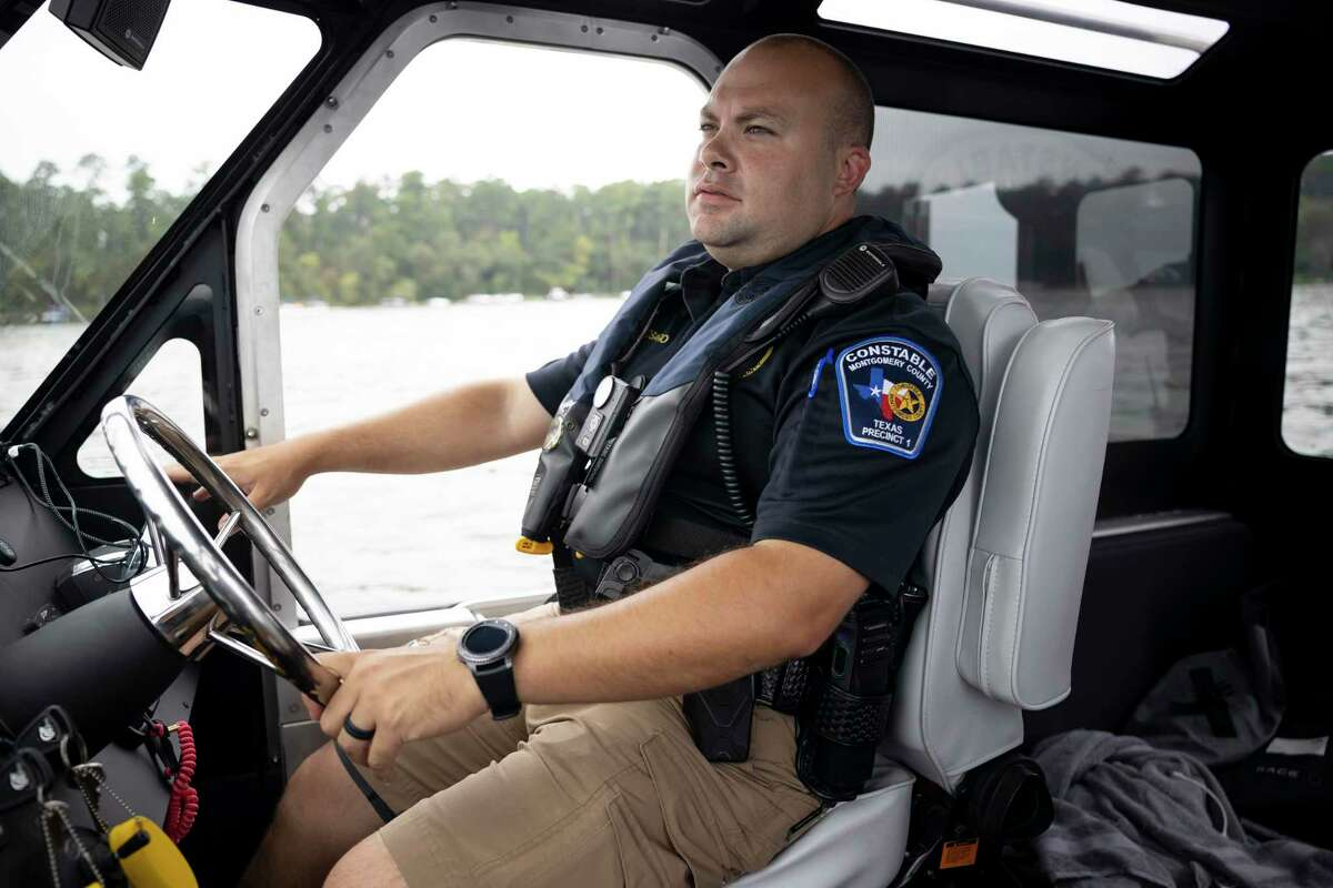 Lt. Miguel Rosario steers a patrol boat as he surveys Lake Conroe, Saturday, Sept. 5, 2020. Due to the COVID-19 pandemic the 21,000-acre lake has seen a huge increase in visitors after most businesses were forced to shut down.