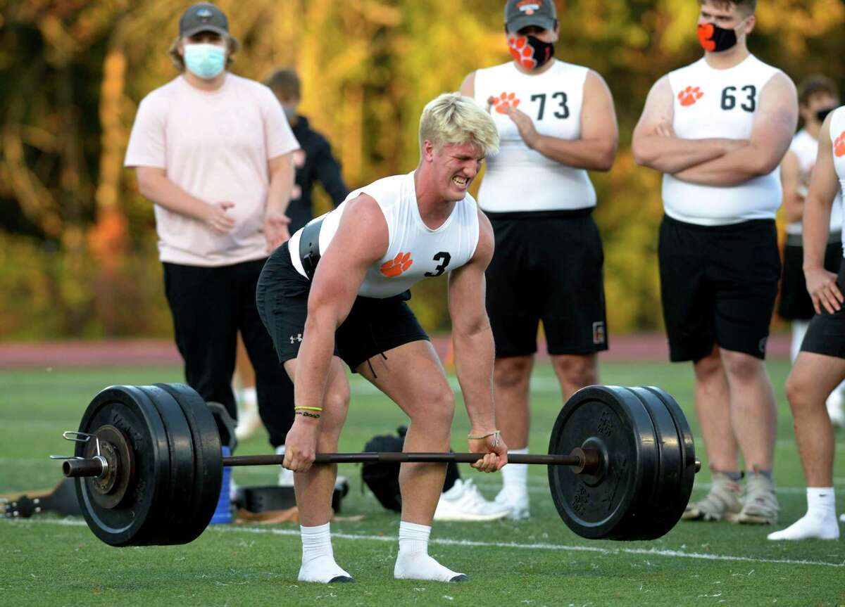 Jackson Trotter competes in the lineman challenge dead lift during boys football, Wilton and Ridgefield high schools. It included the lineman challenge and seven on seven football. Friday, October 2, 2020, at Ridgefield High School, Ridgefield, Conn.