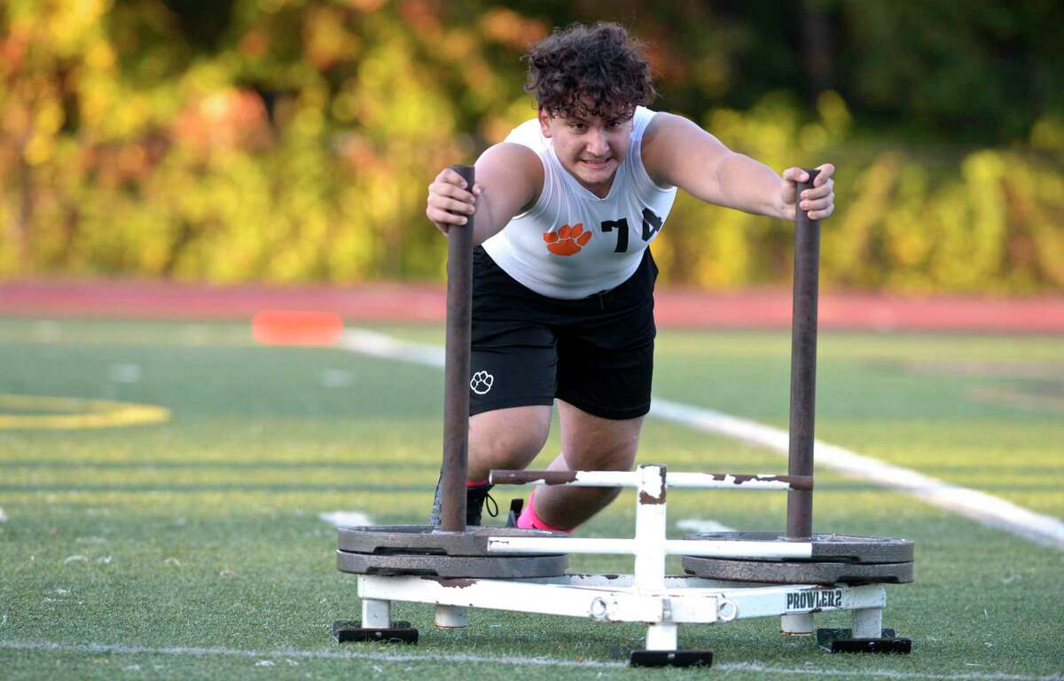 Ridgefield's Elton Coku competes in the lineman challenge medley event during boys football, Wilton and Ridgefield high schools. It included the lineman challenge and seven on seven football. Friday, October 2, 2020, at Ridgefield High School, Ridgefield, Conn.