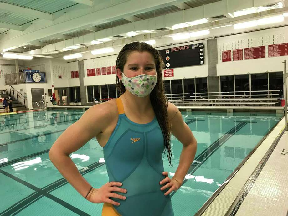 Greenwich senior Meghan Lynch broke the team's 500-yard freestyle record and tied the 50-yard freestyle record in the Cardinals' meet against Westhill/Stamford on Friday in Greenwich. Photo: David Fierro / Hearst Connecticut Media / Connecticut Post