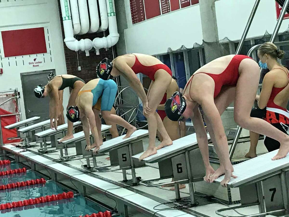 The Greenwich and Westhill/Stamford girls swimming teams opened their season on Friday in Greenwich.
