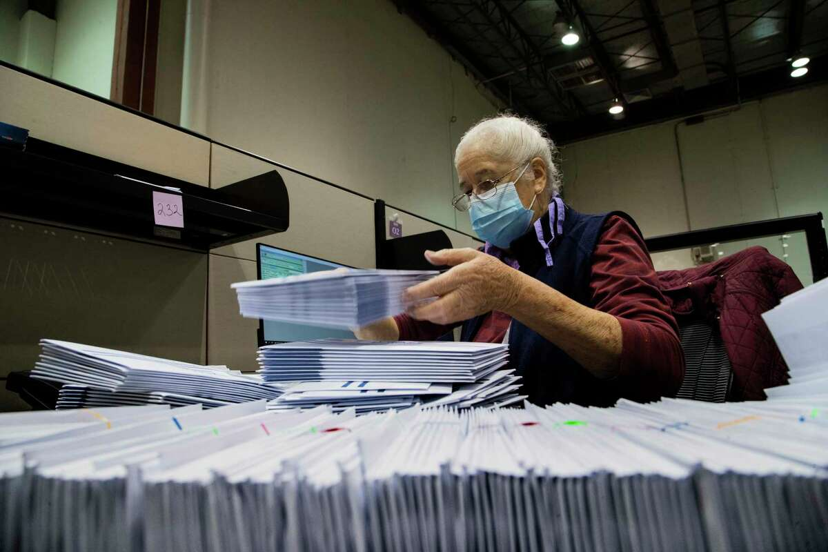 Harris County clerk Judith Rubio, sorts early voting by mail ballots at the Harris County elections headquarters on Friday, Sept. 25, 2020, in Houston.