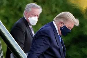 President Donald Trump arrives at Walter Reed National Military Medical Center, in Bethesda, Md., Friday on Marine One after he tested positive for COVID-19.