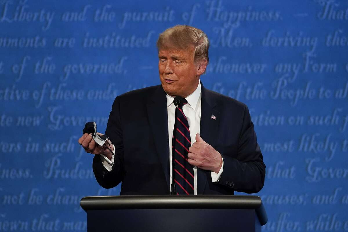 President Trump looks at his mask during the first presidential debate at Case Western Reserve University and Cleveland Clinic on Tuesday.