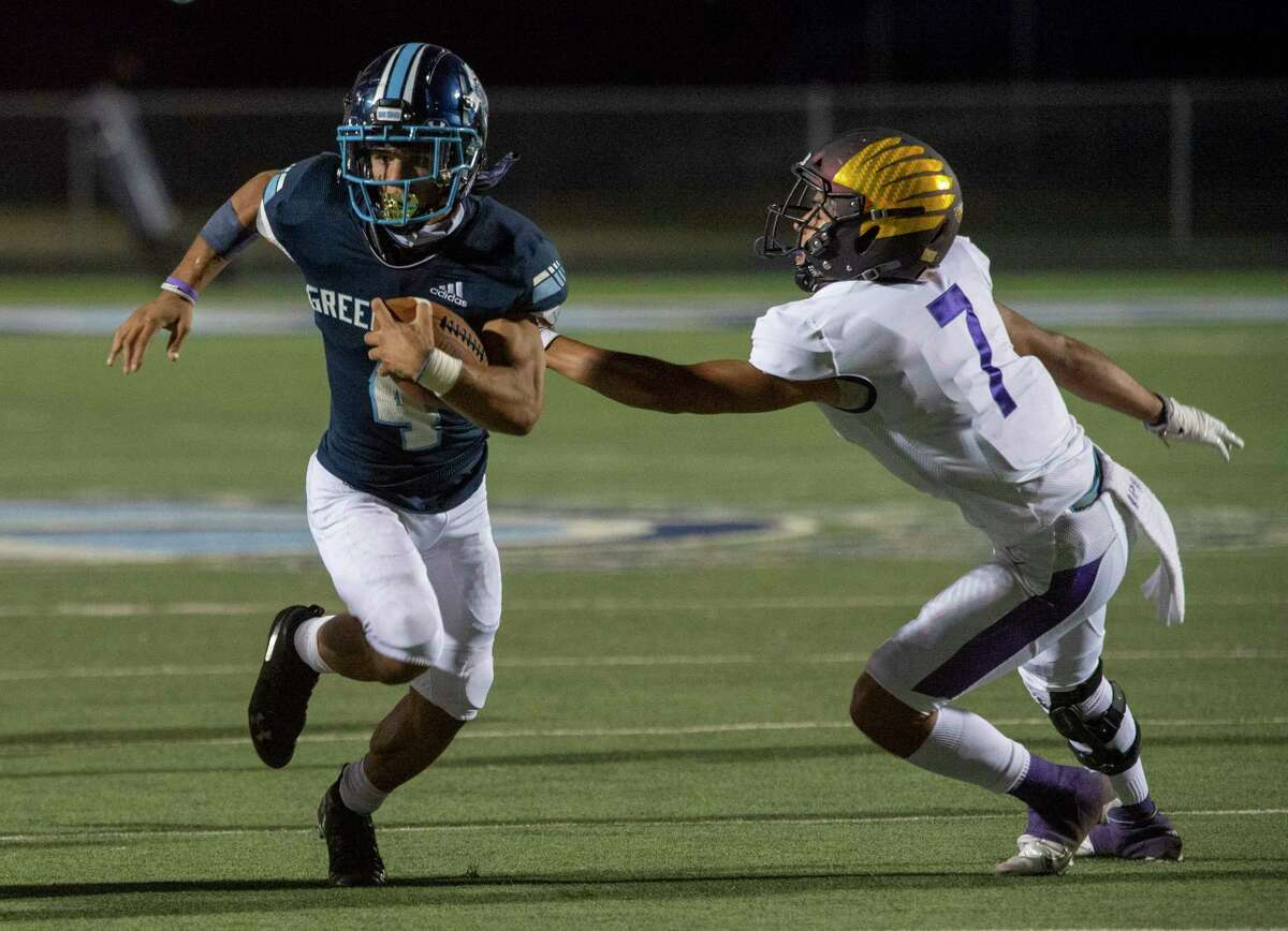 Greenwood's Trey Cross gets past Pecos' Diego Rodriguez on his way to one of his touchdowns 10/02/2020 at J.M. King Memorial Stadium. Tim Fischer/Reporter-Telegram