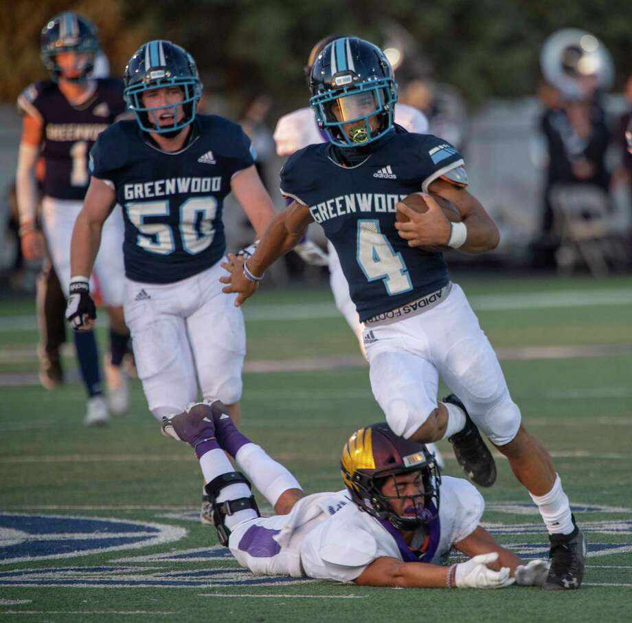 Greenwood's Trey Cross runs through the diving arms of Pecos' Hugo Estrella on the way to one of his touchdowns 10/02/2020 at J.M. King Memorial Stadium. Tim Fischer/Reporter-Telegram Photo: Tim Fischer, Midland Reporter-Telegram
