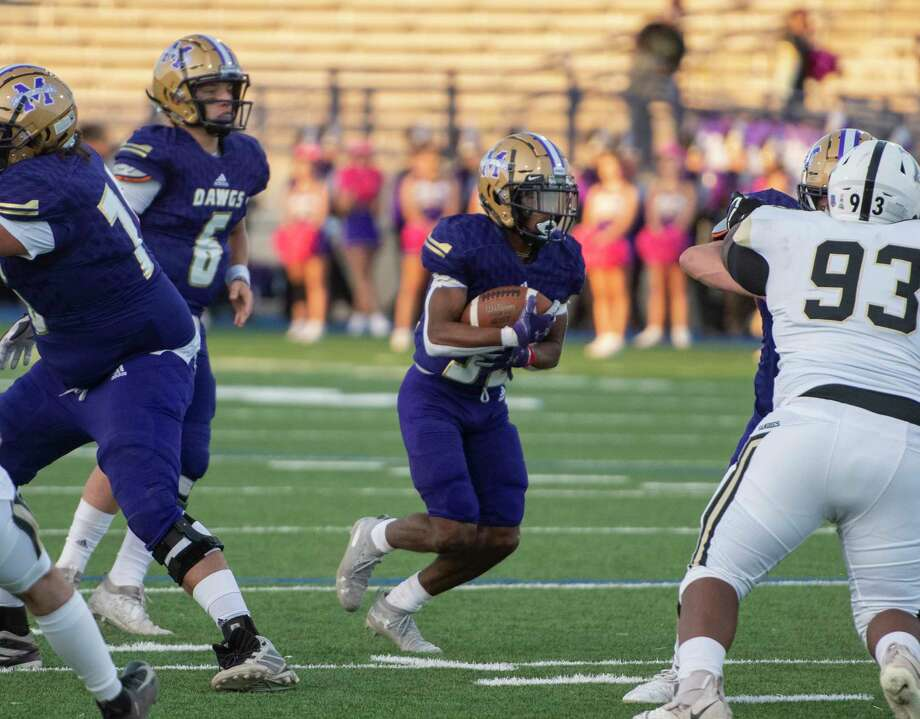 Midland High's Daniel Garcia runs the ball Friday, Oct. 2, 2020 at Grande Communications Stadium. Jacy Lewis/Reporter-Telegram Photo: Jacy Lewis/Reporter-Telegram / MRT