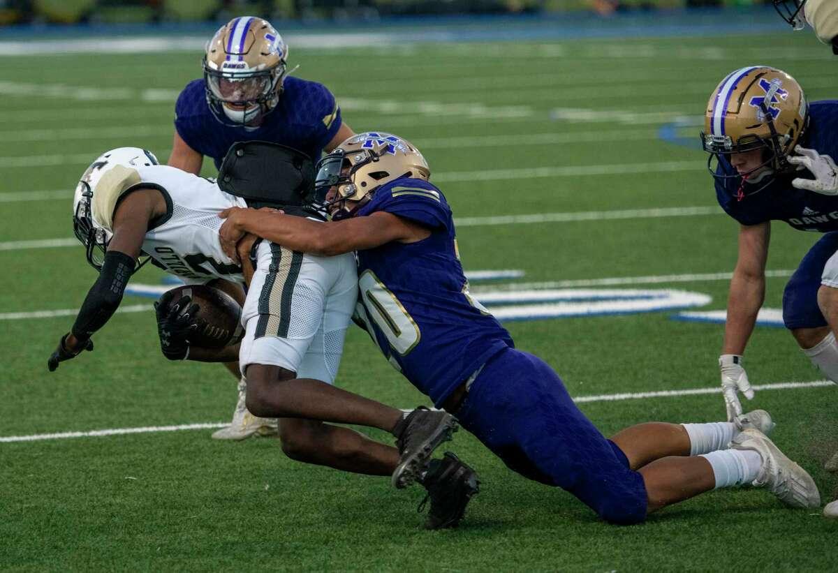 Midland High's Alex Rodriquez tackles Amarillo High's Tyreese Molden on Friday, Oct. 2, 2020 at Grande Communications Stadium. Jacy Lewis/Reporter-Telegram