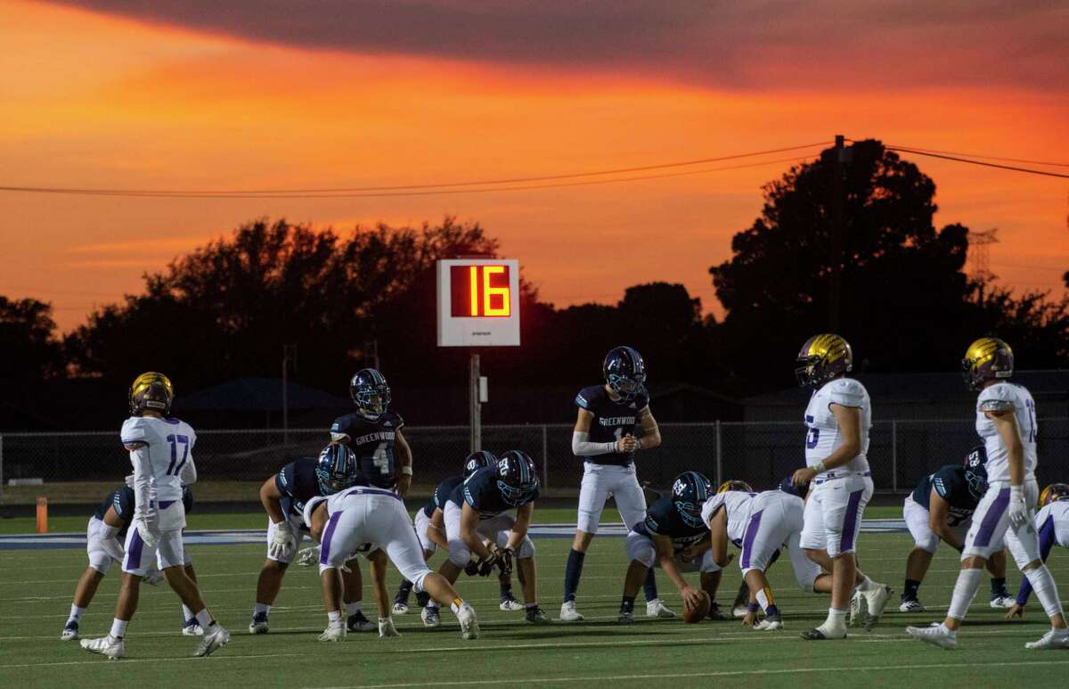 Greenwood and Pecos players come to the line of scrimmage 10/02/2020 at J.M. King Memorial Stadium as the sun sets in the secong quarter. Tim Fischer/Reporter-Telegram