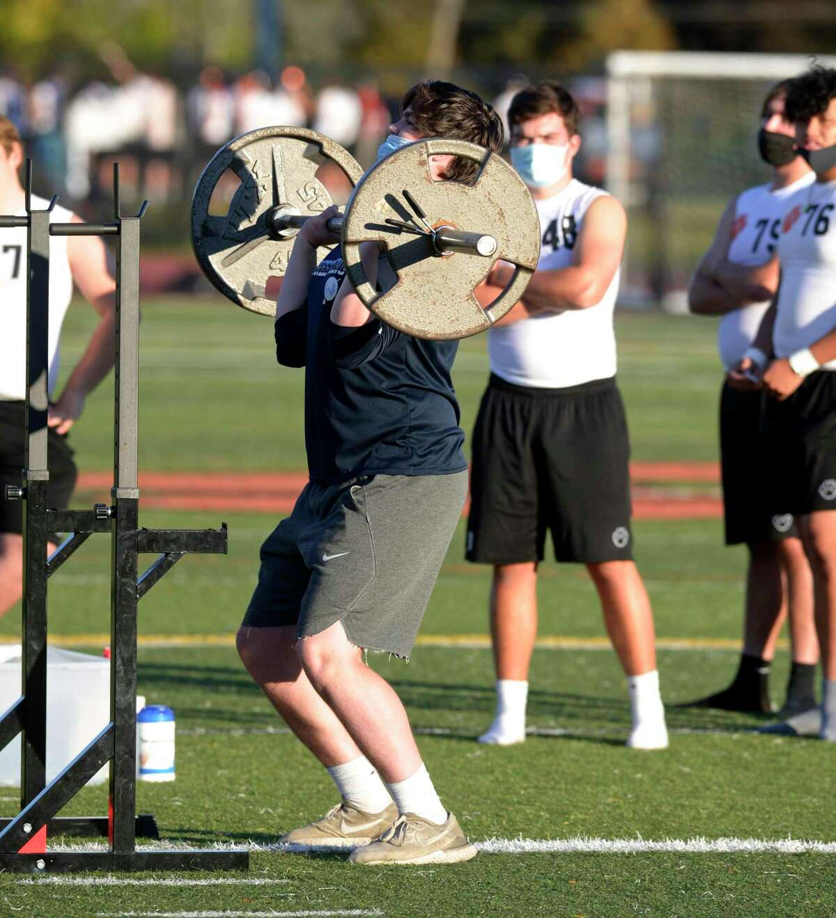 Wilton's Eddie Keller competes in the lineman challenge overhead press during boys football, Wilton and Ridgefield high schools. It included the lineman challenge and seven on seven football. Friday, October 2, 2020, at Ridgefield High School, Ridgefield, Conn.