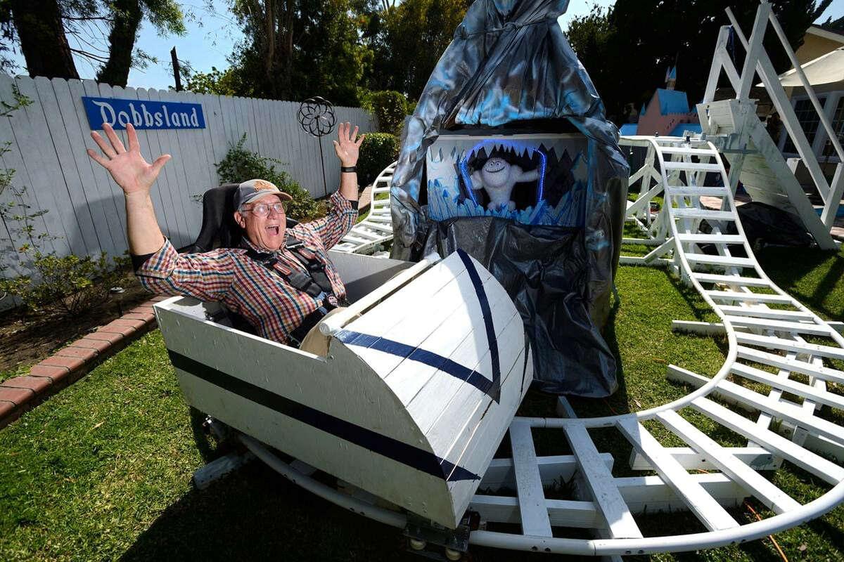 Steve Dobbs riding his Madderhorn roller coaster at his backyard theme park, Dobbsland