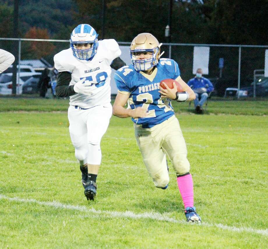Johnny Neph scrambles out of the pocket looking for positive yardage during the first quarter of Onekama's loss to Inland Lakes on Friday. Photo: Robert Myers/News Advocate