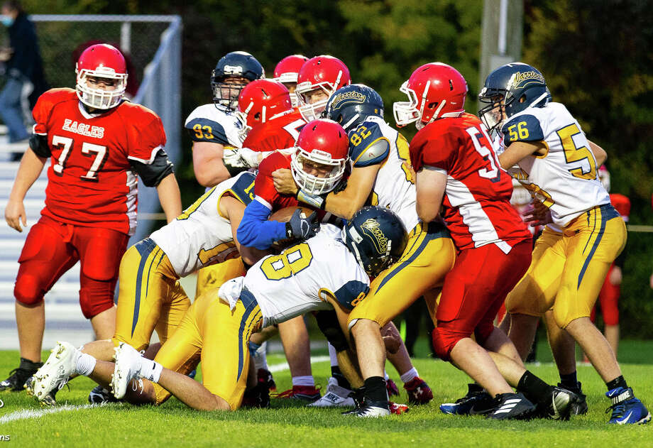 The North Huron Warriors traveled to Caseville on Friday night, where the Warriors rolled past the Eagles, 54-6 and improved to 3-0 on the season. Photo: Quad N Productions/For The Tribune  / Quad N Productions