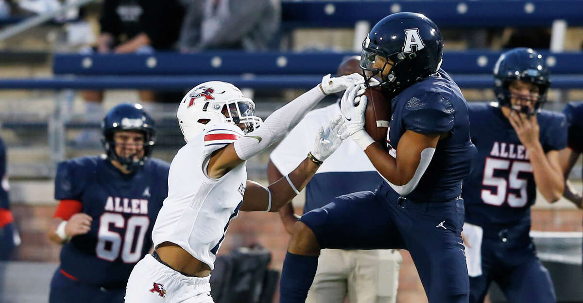 Allen's Bryson Green (9) catches a pass in front of Humble Atascocita's Jordan Augustine (1) during the first quarter of play at Eagle Stadium in Allen, Texas on Friday, October 2, 2020. (Vernon Bryant/The Dallas Morning News)