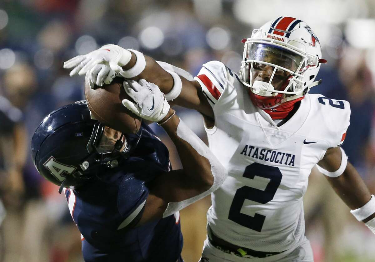 Allen's Blaine Green (8) gets the ball knocked out of his hands by Humble Atascocita's Caleb Burton (2) during the second quarter of play at Eagle Stadium in Allen, Texas on Friday, October 2, 2020. Atascocita was called for a pass interference penalty on this play. (Vernon Bryant/The Dallas Morning News)