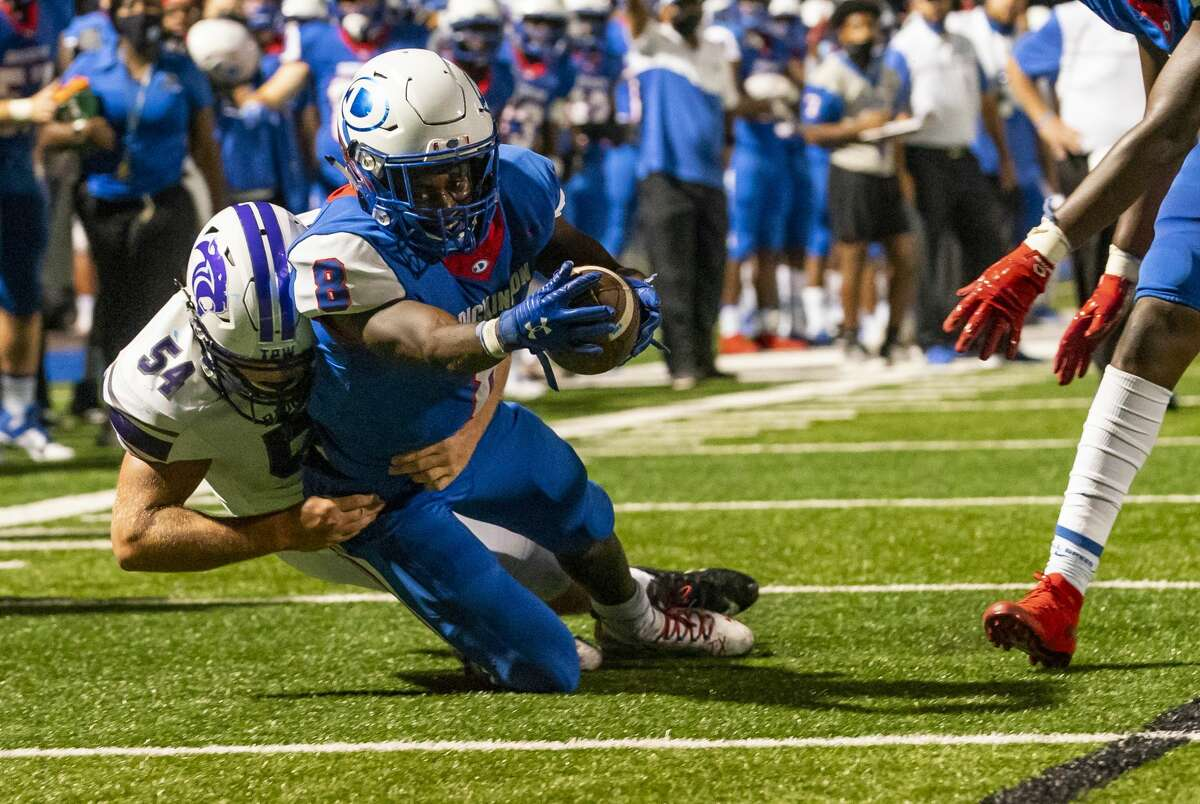 Dickinson running back Ausaru Allah (8) dives into the end zone for a touchdown during the second half of a high school football game between the Dickinson Gators and the Ridge Point Panthers, Friday, October 2, 2020, at Sam Vitanza Stadium in Dickinson.