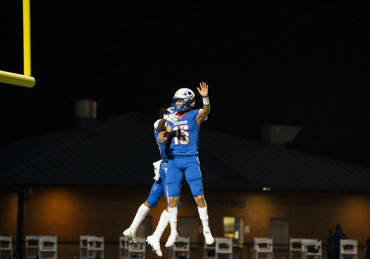 Dickinson wide receiver Jarell Simpson (3) and quarterback Graham Ledbetter (15) celebrate Simpson's second quarter touchdown reception during a high school football game between the Dickinson Gators and the Ridge Point Panthers, Friday, October 2, 2020, at Sam Vitanza Stadium in Dickinson.