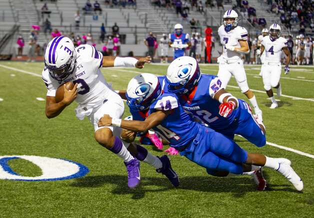 Ridge Point quarterback BJ Emanuel (3) pulls Gator defenders VJ Glover (14) and Kristian Mukabana (52) towards the end zone during a high school football game between the Dickinson Gators and the Ridge Point Panthers, Friday, October 2, 2020, at Sam Vitanza Stadium in Dickinson. Photo: Mark Mulligan/Staff Photographer / © 2020 Mark Mulligan / Houston Chronicle