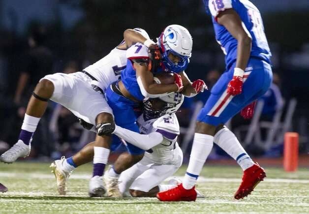Dickinson running back Waylon Presley is tackled during a high school football game between the Dickinson Gators and the Ridge Point Panthers, Friday, October 2, 2020, at Sam Vitanza Stadium in Dickinson. Photo: Mark Mulligan/Staff Photographer / © 2020 Mark Mulligan / Houston Chronicle