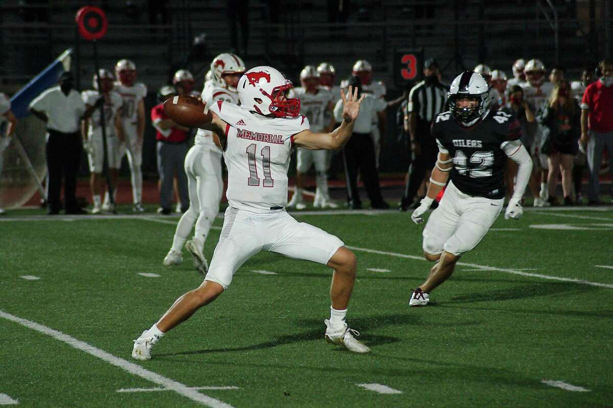 Houston Memorial's Mason Sanders drops back to pass against Pearland Friday, Oct. 2 at The Rig.