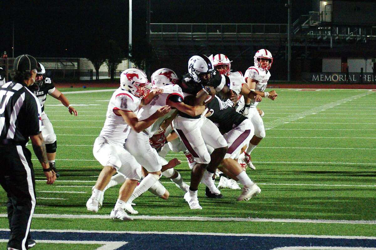 Pearland's Darius Hale (4) muscles into the end zone for a touchdown against Houston Memorial Friday, Oct. 2 at The Rig.