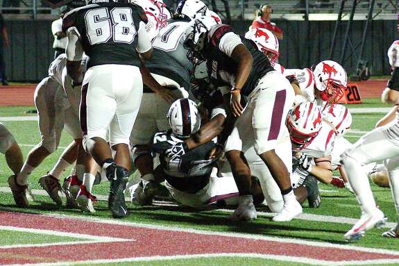 Pearland, shown in action earlier this year against Houston Memorial, defeated Alvin, 48-9, Friday night.