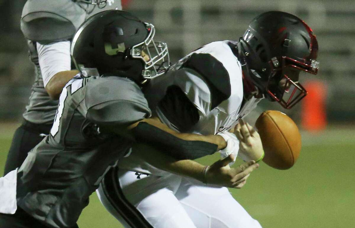 Clark's Ethan Reed (15) jars the ball loose from New Braunfels Canyon quarterback Drew Berry (11) during their football game at Farris Stadium on Friday, Oct. 2, 2020.