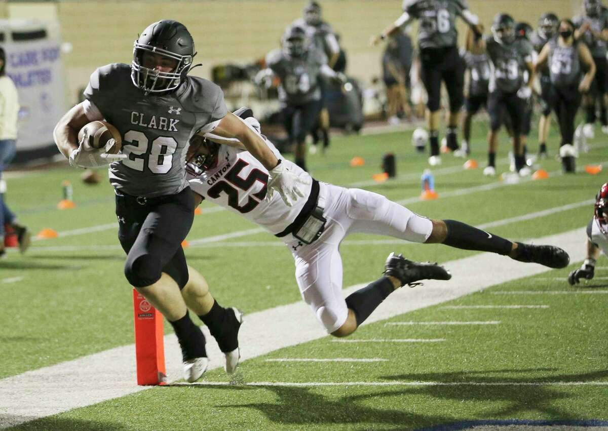 Clark's Niko Varelas (28) outruns New Braunfels Canyon's Jesse Camarillo as he scores a touchdown in the first quarter Friday at Farris Stadium.