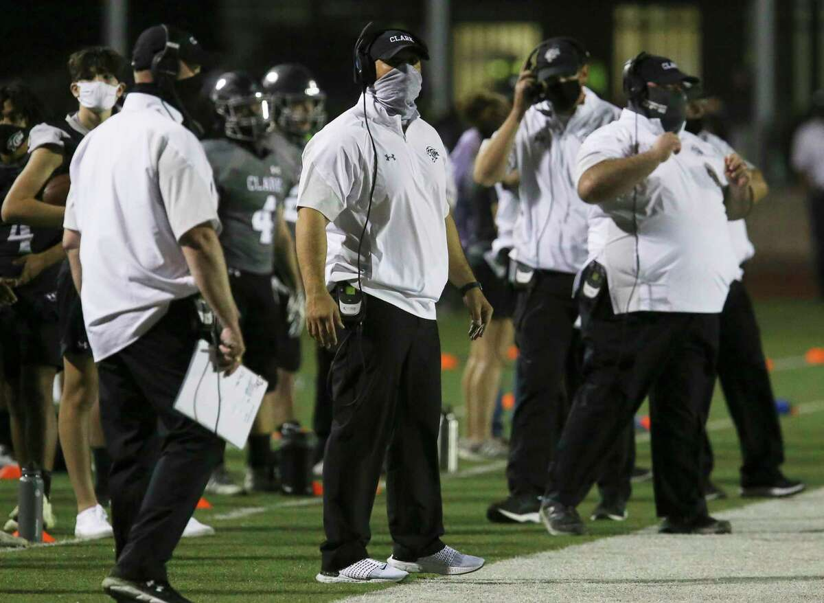 The Clark Cougars football coaches all wear masks during their game against New Braunfels Canyon at Farris Stadium on Friday, Oct. 2, 2020.