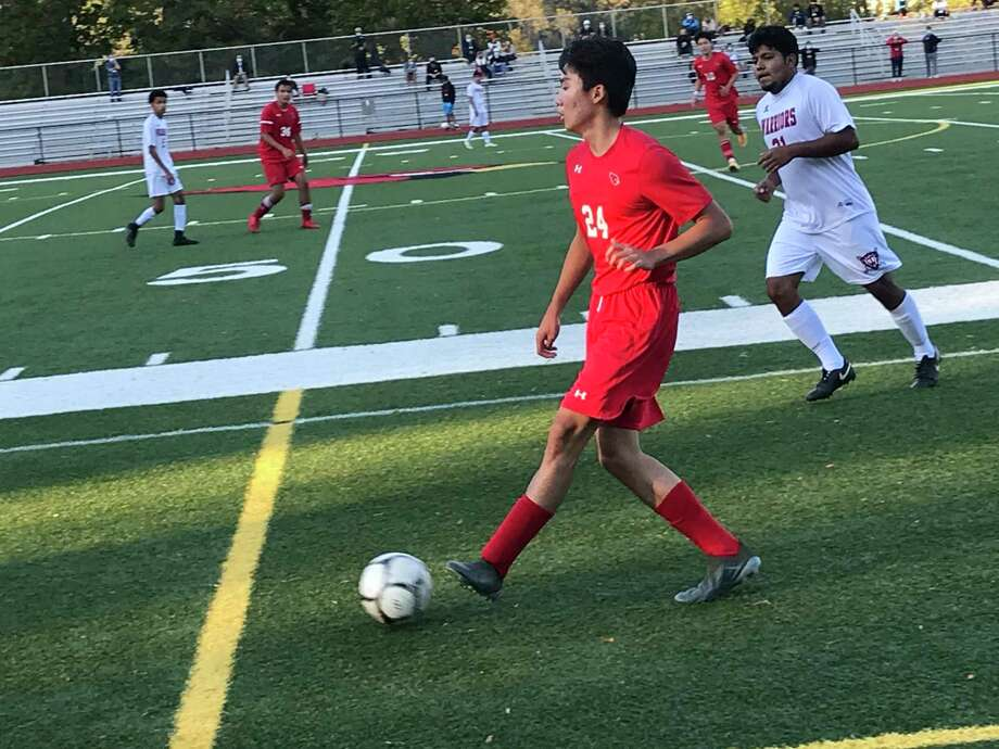 Isaiah Sohn of Greenwich looks to pass during the Cardinals' soccer game on Friday, October 3, 2020, in Greenwich. The Cardinals defeated Wright Tech, 7-0. Photo: Contributed Photo