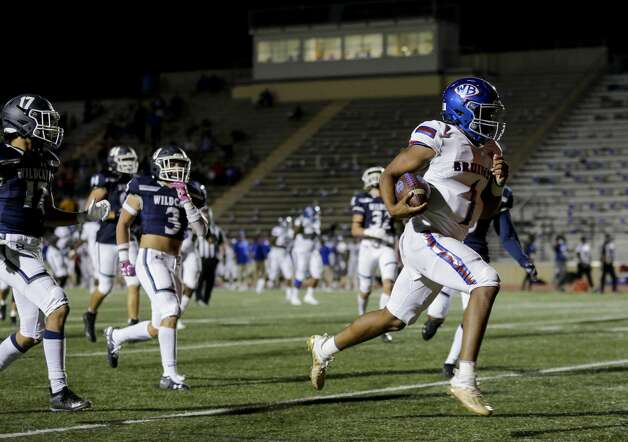 West Brook quarterback Bryce Anderson (1) scores a rushing touchdown against Tomball Memorial during the first half of the game at Tomball ISD Stadium Friday, Oct. 2, 2020, in Tomball, Texas. Photo: Godofredo A Vásquez/Staff Photographer / © 2020 Houston Chronicle