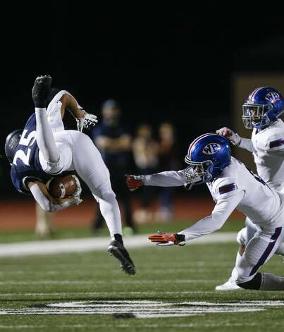 West Brook safety Bradley Koba (9) tackles Tomball Memorial running back Richard Rodriguez (25) during the first half of the game at Tomball ISD Stadium Friday, Oct. 2, 2020, in Tomball, Texas. Photo: Godofredo A Vásquez/Staff Photographer / © 2020 Houston Chronicle