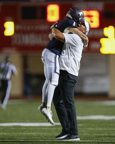 Tomball Memorial quarterback Colton Marwill (4) celebrates with head coach Sam Parker defeating West Brook at Tomball ISD Stadium Friday, Oct. 2, 2020, in Tomball, Texas. Photo: Godofredo A Vásquez/Staff Photographer / © 2020 Houston Chronicle