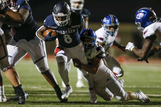 Tomball Memorial running back Sima Dumbuya (8) runs the ball against West Brook during the second half of the game at Tomball ISD Stadium Friday, Oct. 2, 2020, in Tomball, Texas. Photo: Godofredo A Vásquez/Staff Photographer / © 2020 Houston Chronicle