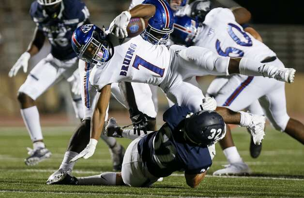 Tomball Memorial defensive back Kale Berter (32) tackles West Brook running back Jamichael Foxall (7) during the second half of the game at Tomball ISD Stadium Friday, Oct. 2, 2020, in Tomball, Texas. Photo: Godofredo A Vásquez/Staff Photographer / © 2020 Houston Chronicle
