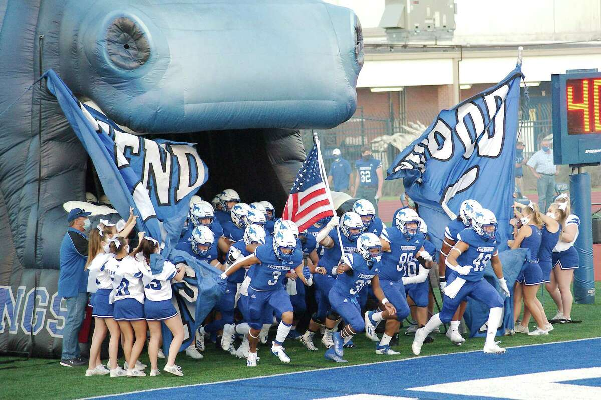 Friendswood rushes onto the field before the game against Clear Brook Friday Oct. 2 at Friendswood High School.