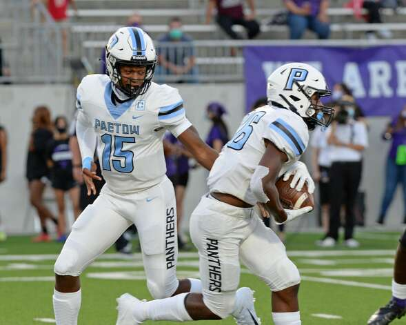 CJ Dumas Jr (15) of Paetow hands off to Damon Bankston (26) of Paetow during the first half of a non-conference football game between the Paetow Panthers and the Morton Ranch Mavericks on Friday, October 2, 2020 at Legacy Stadium, Katy, TX. Photo: Craig Moseley/contributor / ©2020 Craig Moseley