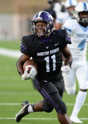 Santana Scott (11) of Morton Ranch reacts after scoring a touchdown during the first half of a non-conference football game between the Paetow Panthers and the Morton Ranch Mavericks on Friday, October 2, 2020 at Legacy Stadium, Katy, TX. Photo: Craig Moseley/contributor / ©2020 Craig Moseley