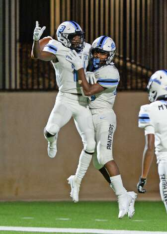 Kole Wilson (11) and Damon Bankston (26) of Paetow celebrate a touchdown during the second half of a non-conference football game between the Paetow Panthers and the Morton Ranch Mavericks on Friday, October 2, 2020 at Legacy Stadium, Katy, TX. Photo: Craig Moseley/contributor / ©2020 Craig Moseley