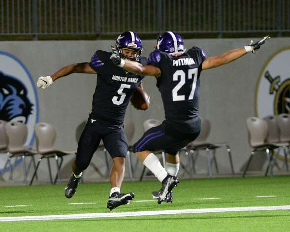 Jaelon Davis (5) and Jacob Pittman (27) of Morton Ranch react after a touchdown during the second half of a non-conference football game between the Paetow Panthers and the Morton Ranch Mavericks on Friday, October 2, 2020 at Legacy Stadium, Katy, TX. Photo: Craig Moseley/contributor / ©2020 Craig Moseley