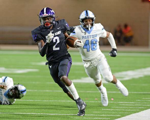 Jermichael Johnson (2) of Morton Ranch carries the ball for a first down during the second half of a non-conference football game between the Paetow Panthers and the Morton Ranch Mavericks on Friday, October 2, 2020 at Legacy Stadium, Katy, TX. Photo: Craig Moseley/contributor / ©2020 Craig Moseley