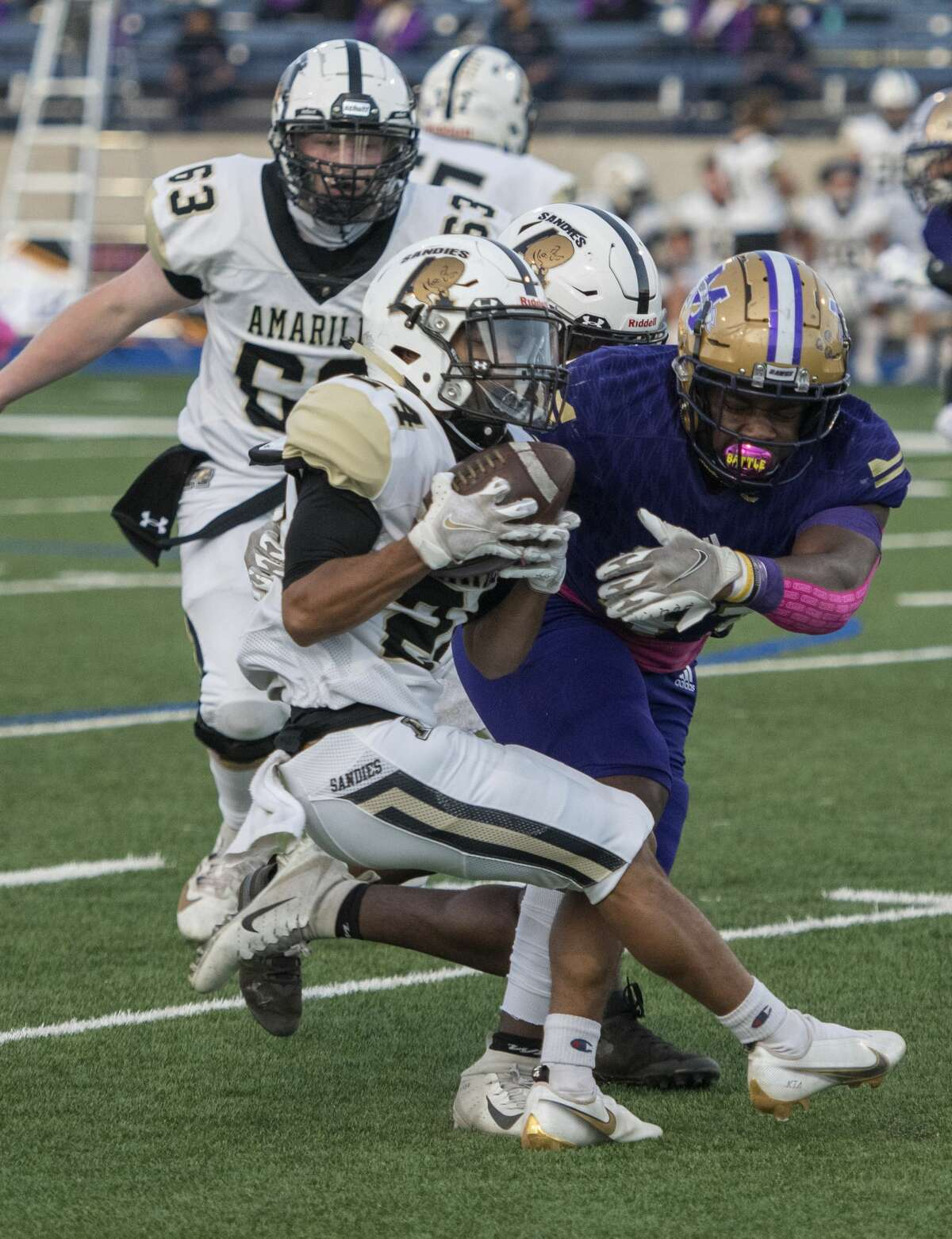 Midland High's Jordan Springer attempts to tackle Amarillo High'?•s Teavon Hood on Friday, Oct. 2, 2020 at Grande Communications Stadium. Jacy Lewis/Reporter-Telegram