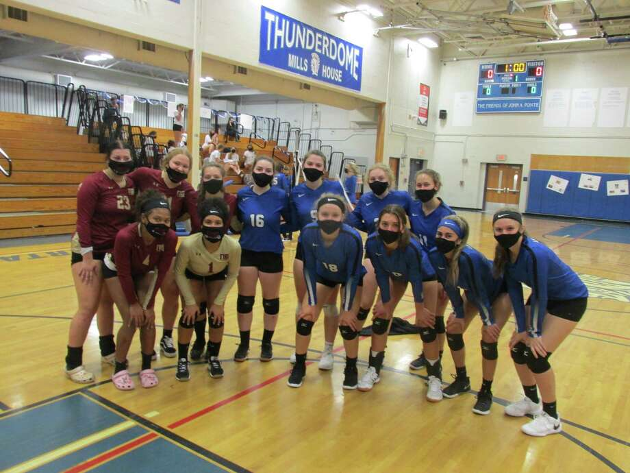 The New Britain and Lewis Mills girls volleyball teams opened their season on Friday, October 2, 2020 in Burlington, Conn. Photo: Peter Wallace / For Hearst Connecticut Media / Stamford Advocate Freelance
