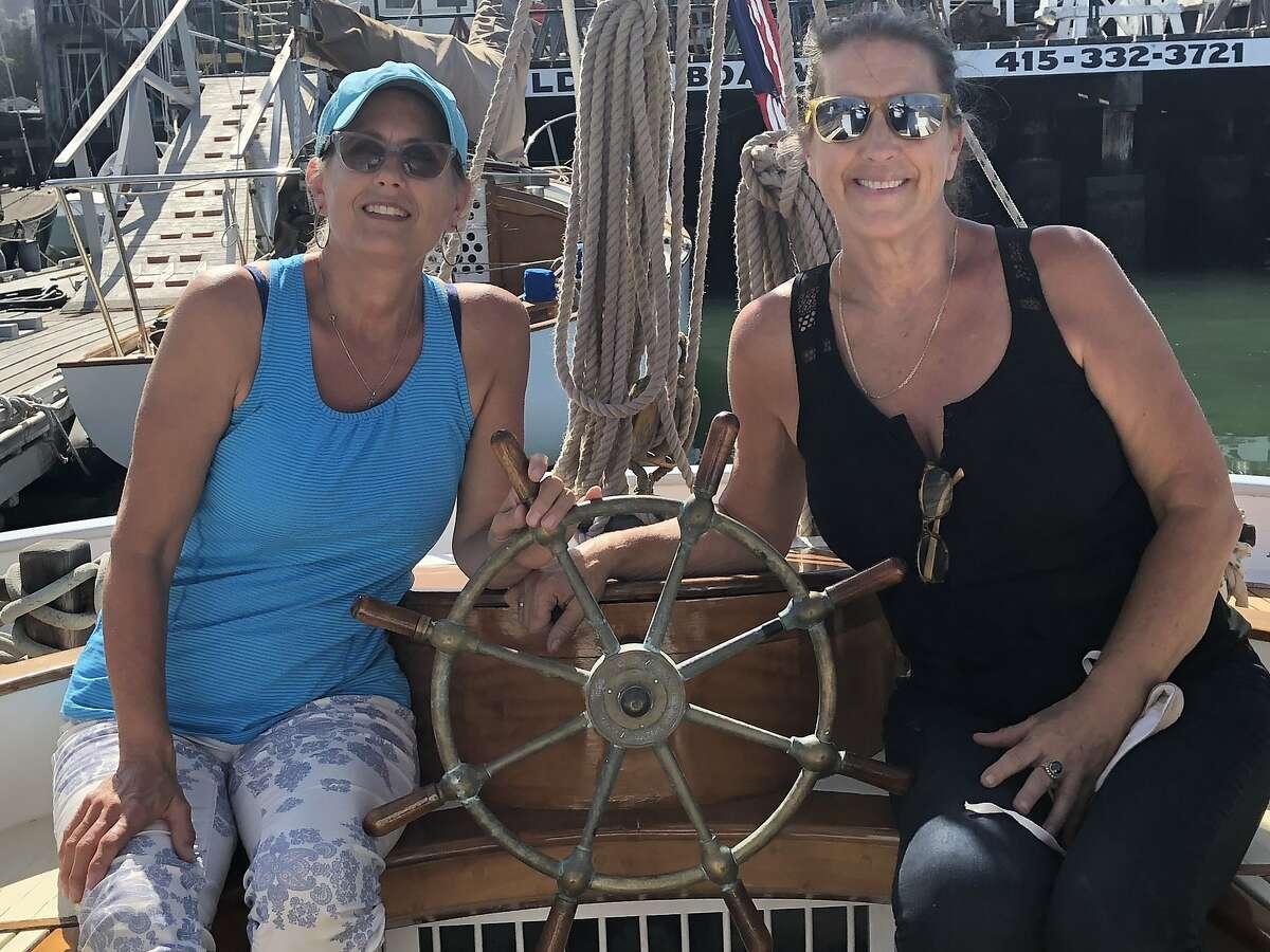 Inga (left) and Berit Larsen aboard the sailing yacht Freda.