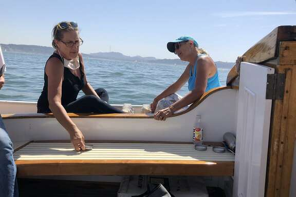 Berit ( left) and inhale Larsen about to cast their fsther Dave Larsen summer ashes outside the golden gate. Second pix is of Krause Lange on thenyachtbfreda last pix is the Golden Gate Bridge