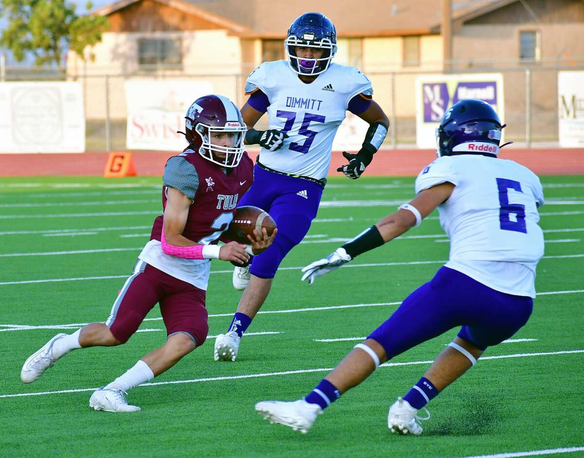 Tulia's Brayden Franco slices his way through a pair of Dimmitt defenders during their District 3-3A Division II high school football game on Friday, Oct. 2, 2020 in Tulia.